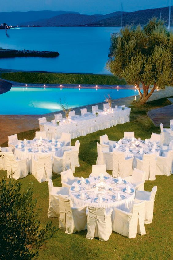 Spectacular outdoor all-white wedding at Porto Elounda Golf and Spa Resort, Crete, Greece. Love how the sea extends the water from the pool.