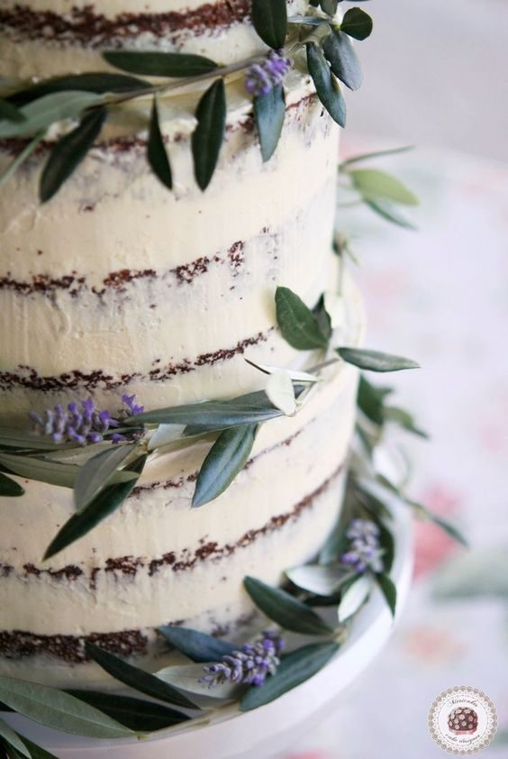 Semi naked winery-inspired wedding cake with olive branches and lavender.