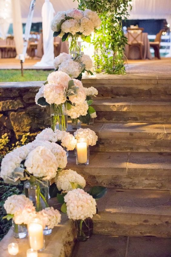 Hydrangeas, high and low candles stair decor.