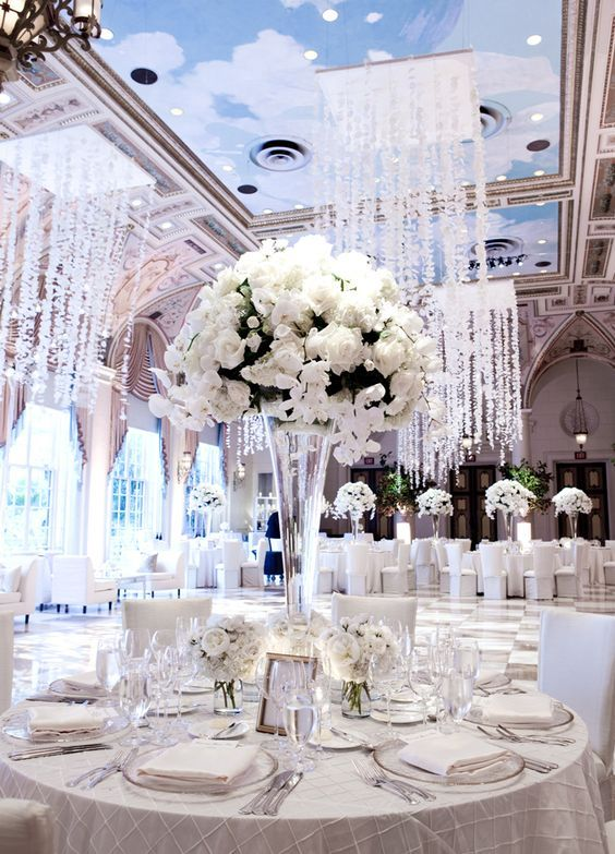 Love how the centerpieces are transparent so as not to block the guest's view. Also that ceiling is amazing.