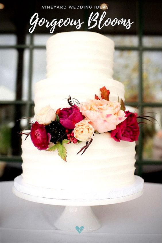 Gorgeous blooms over this vineyard wedding cake.