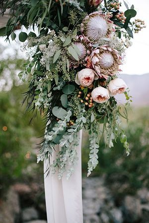 Protea and greenery vineyard wedding decor ideas. Vineyard wedding ideas.
