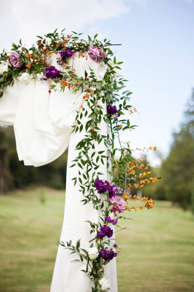 Burgundy, purple, and orange vineyard wedding decor. Photography: Jen And Chris Creed.