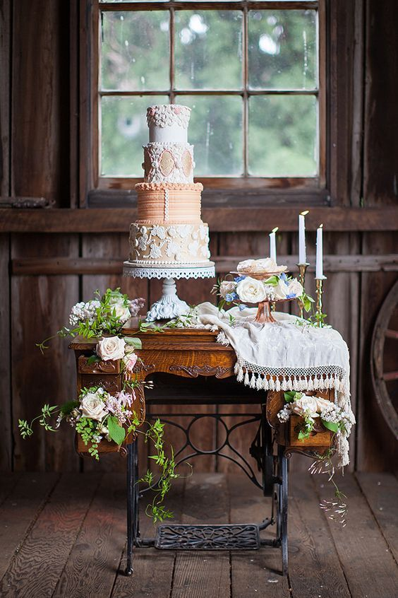 Perfect table to accompany this cake by Sugar Cubed Cake Creations over an old sewing table, roses and a mantilla.