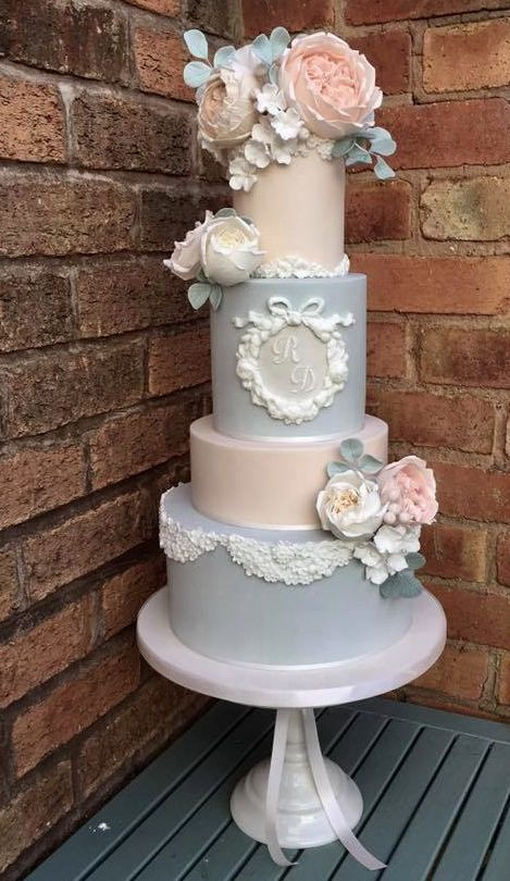 Delicate vintage wedding cake in blush and blue with lace details inspired in the bride's gown by Cotton and Crumbs.