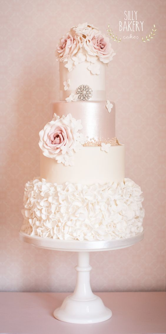 Ruffles, satin and edible roses are indicative of vintage wedding cakes. Perfect for a Paris-themed wedding.