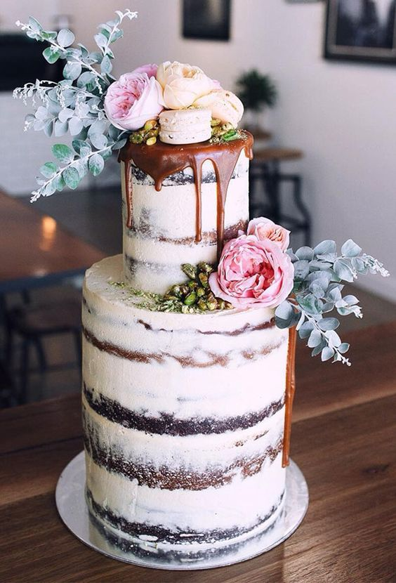 Vintage wedding cakes can also be on trend. Check out this dark chocolate brownie salted caramel floral drip cake with coconut and pistachio.