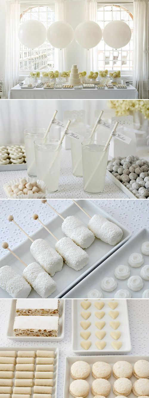 Tempting and irresistible wedding dessert table in white by Amy Atlas.
