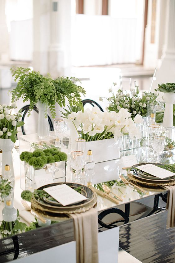 Modern, fresh and super cool white wedding with whimsical centerpieces mixing white and greenery.