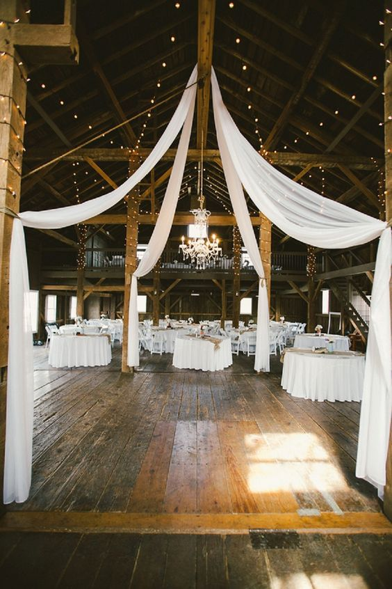 Lovely and whimsical white wedding at a barn!
