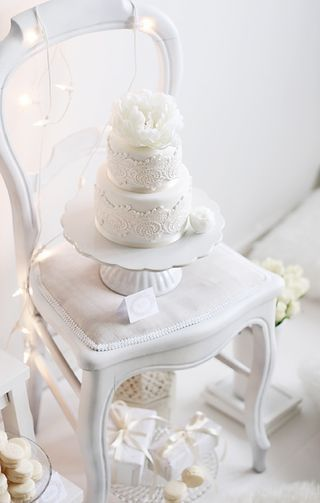 White cake on a white chair.
