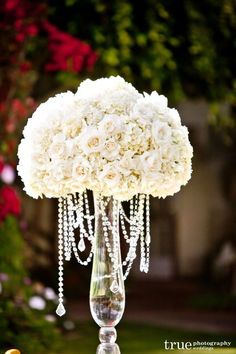 Perfection with tall, dramatic ivory and white silk flower centerpieces. Not too hard to put together and with a swanky vintage vibe.