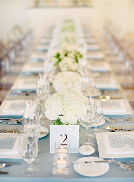 Centerpieces, butterflies place cards, menus folded into napkins and votives... So clean and simple!