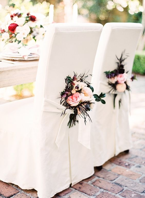 Glamorize your white wedding chairs with a pop of color. New Orleans wedding. Photographer: Marissa Lambert.