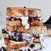 Fontina, blackberry & basil smash grilled cheese sandwiches. They'll disappear before you can say cheese!