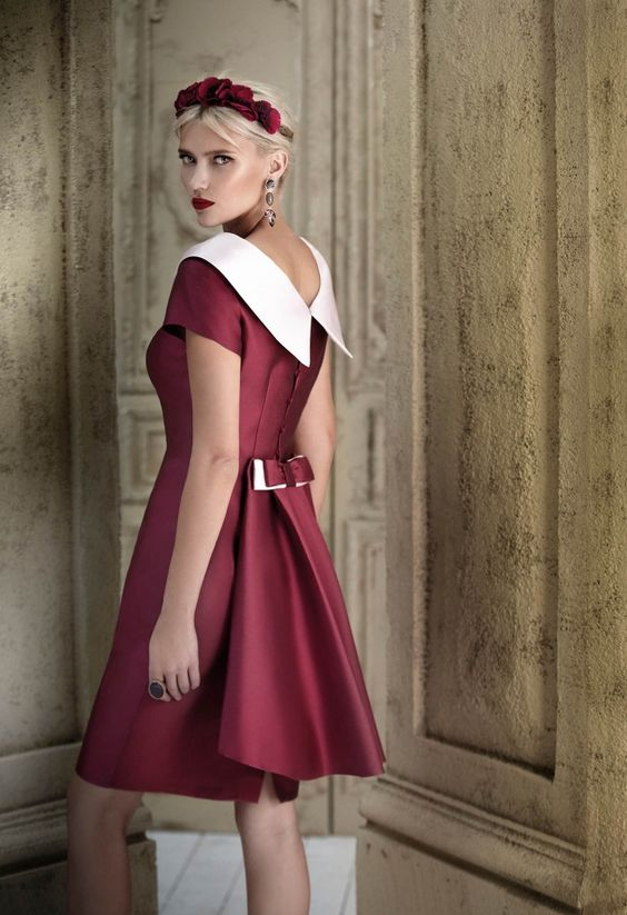This berry-hued cocktail dress will fit perfectly at a winter wedding.