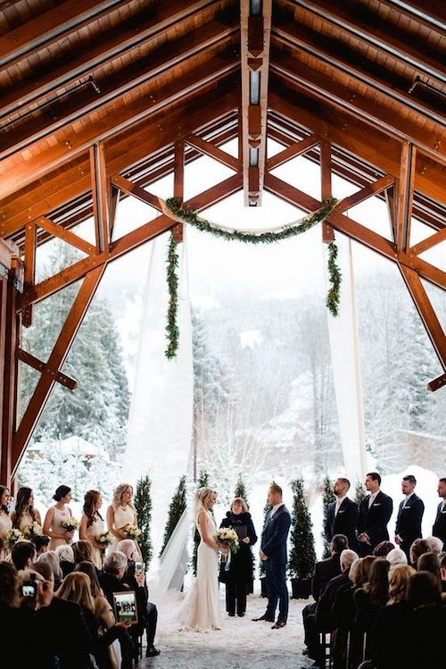Stunning black and white winter wedding ceremony. Photo: Christie Graham Photography.