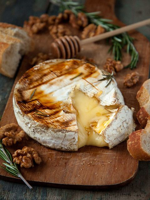 Baked brie with rosemary, honey, & candied walnuts a delicious dish for winter time.