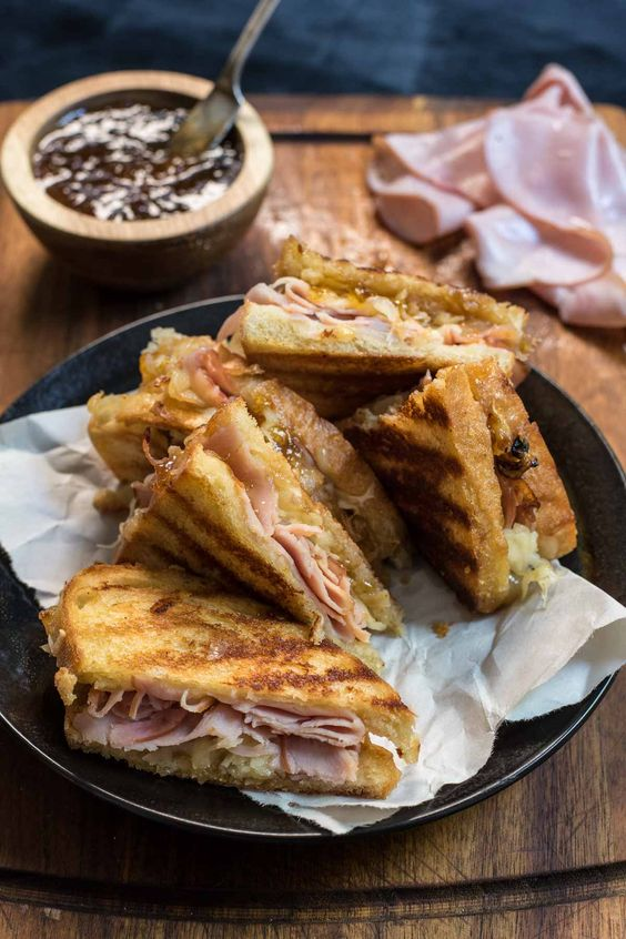 Loaded with melty gruyere, ham slices, caramelized onions, and fig jam a delight for the senses.