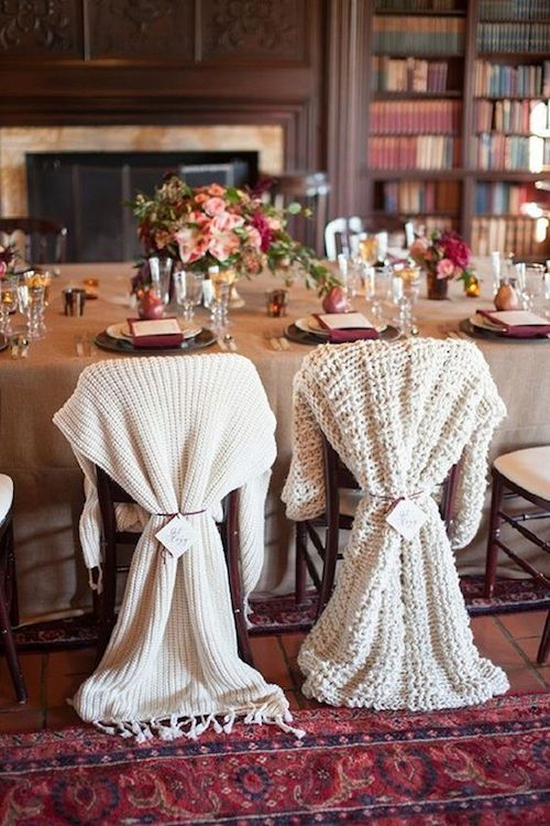 Celebrate an intimate winter wedding in the cozy space of a library. Warm blankets dress up the reception chairs. Photo: Rahel Menig Photography.
