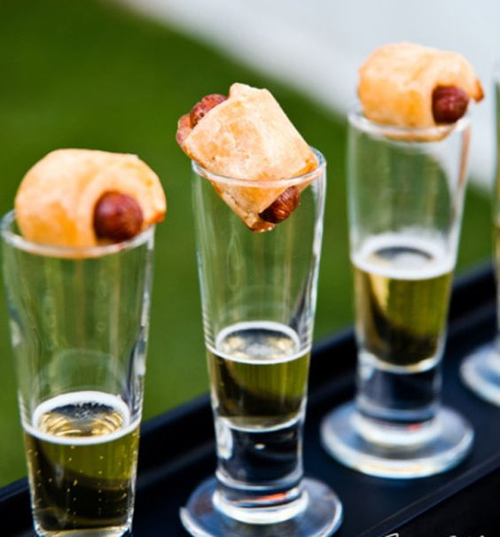 Who says we can't get tipsy with mini foods at weddings? Pair mini pigs in a blanket with a shot of beer. A wonderful flavor combination.