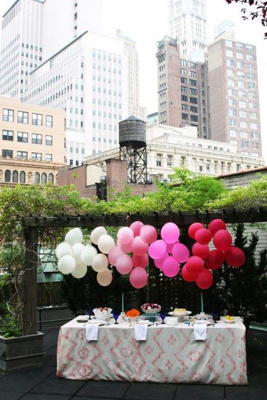 Lovely balloon decor for the mini wedding food table at a rooftop or backyard.