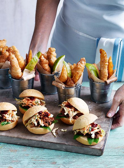 When it comes down to mini wedding foods the presentation is key. Check out these mini buckets and the wooden table used to serve these pork sliders.