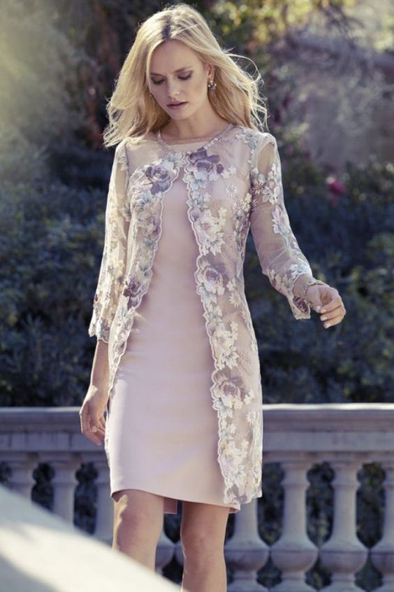 Nude dress and jacket ensemble. Romantic dress with long jacket covered in embroidered flowers.