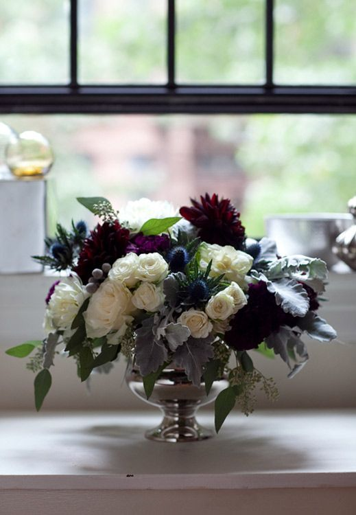 Black and white with a touch of eggplant winter wedding flower arrangement.