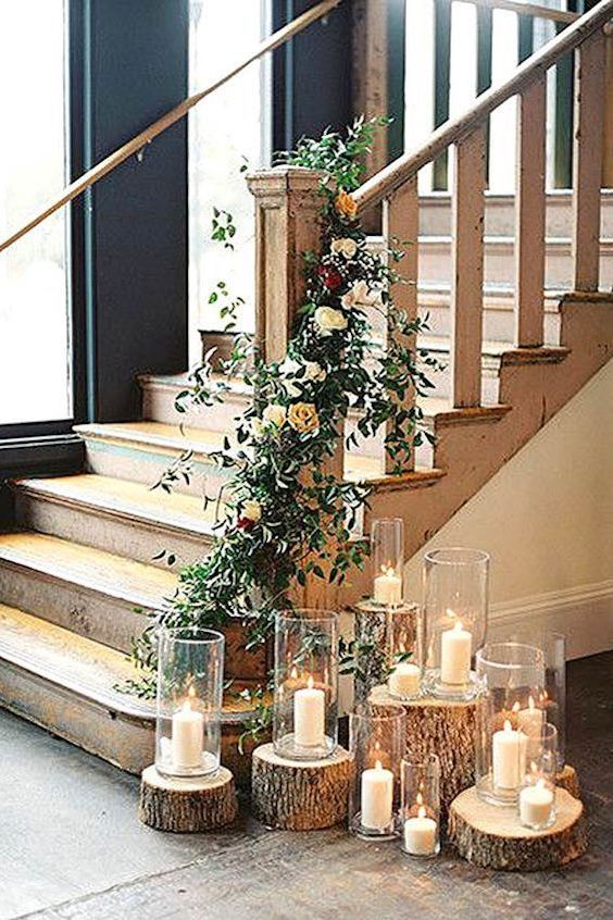 Looking for winter wedding ideas? Candles, wooden slabs and a flower wreath will add intimate charm to your reception decor.