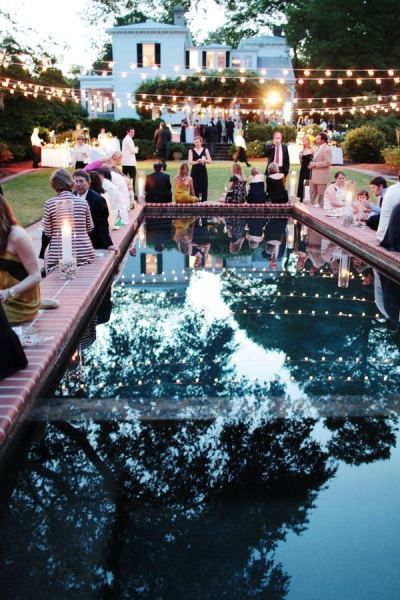 Southern couples can host their after-party blowout by a lit pool on their backyard. Swoon!