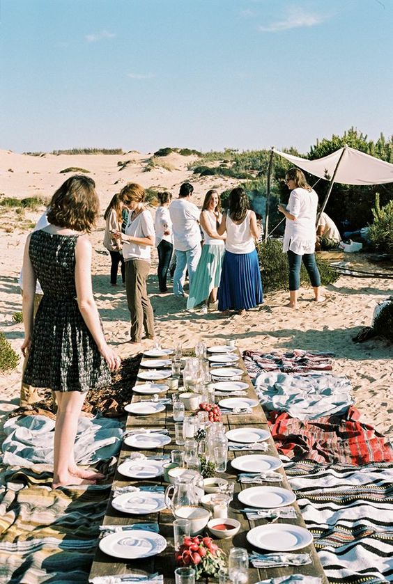 Hang out after the wedding reception with your framily at the beach. Perfect for the most boho of couples.