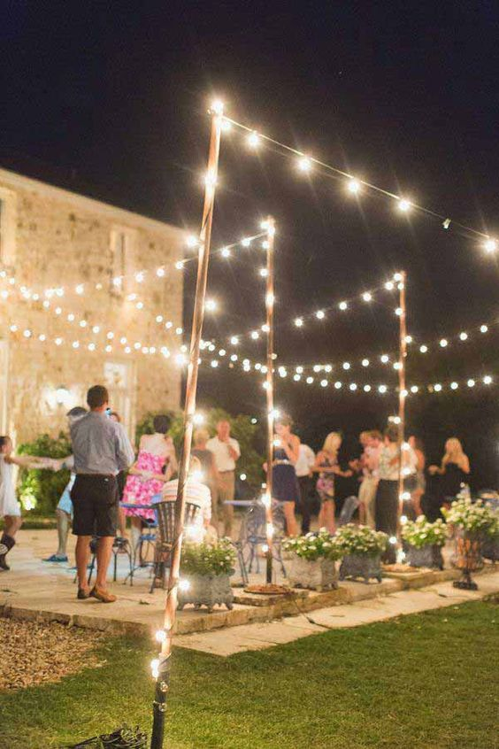 Decorate your backyard with patio string lights.
