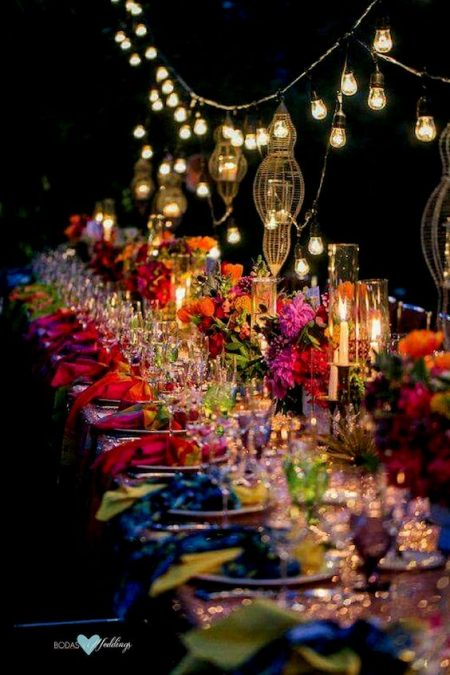 A bohemian table setting for an all out wedding after-party.