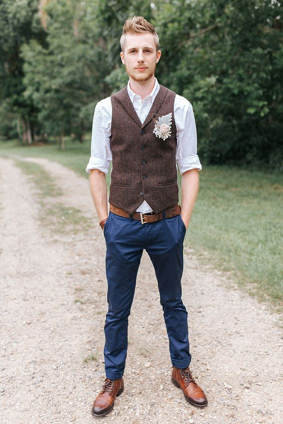 The groom attire is definitely boho and casual with a brown vest and navy blue trousers. Mallory Sparkles Photography.