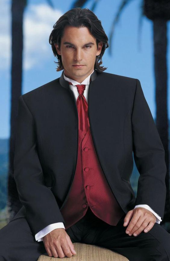 Contrasting cummerbund and tie paired with a classic tuxedo.