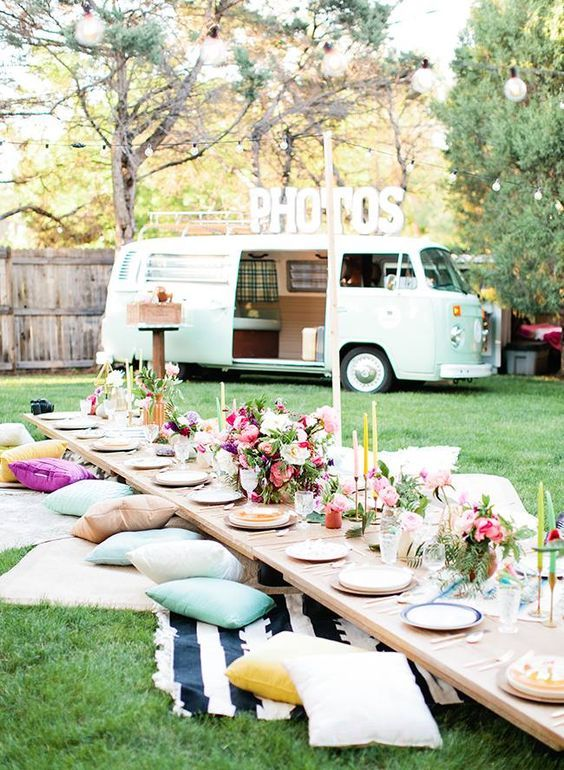 Unique decor for a picnic after-party with Photo Booth. Let the good times roll!