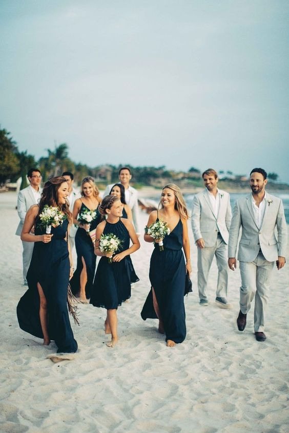 Lovely destination wedding on the beach in Mexico. Bridesmaids in navy blue..