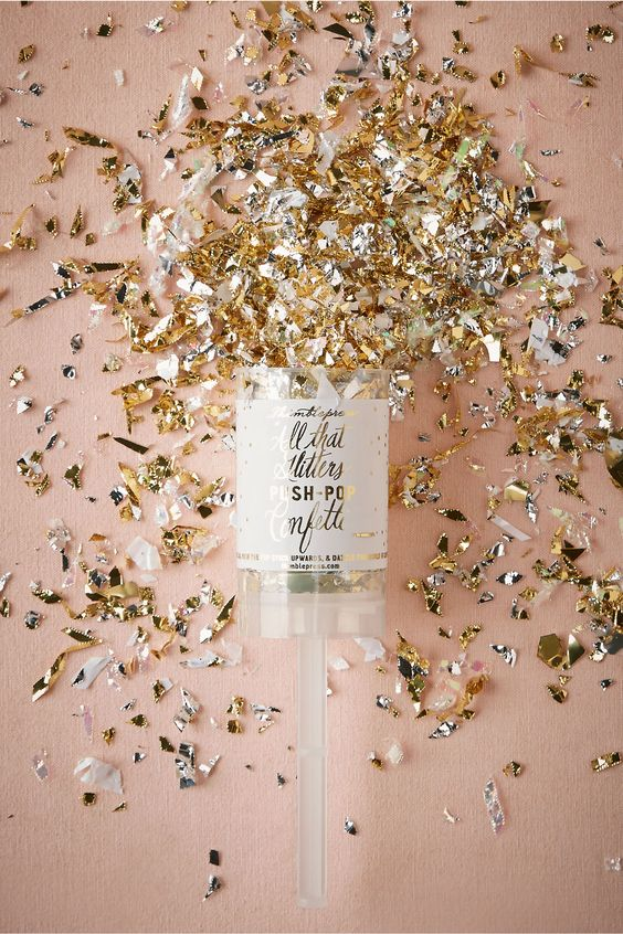 Arm yourself with some glitter and glam confetti push pops for the sendoff! Via BHLDN.