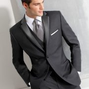 Slender grooms can wear a higher button stance, like on this three piece tuxedo.