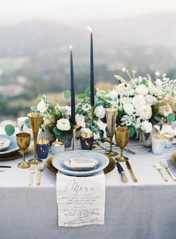 Romance and bohemian go hand in hand on this mountaintop wedding. Color scheme navy blue, marina blue, gold and greenery.