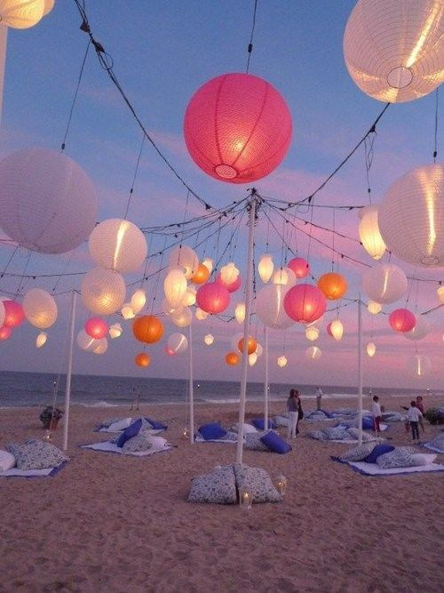 Who hasn't dreamt of a post wedding reception at the beach? Love the decor.