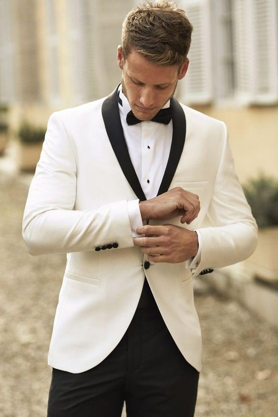 Two button single breasted tuxedo in ivory and black.