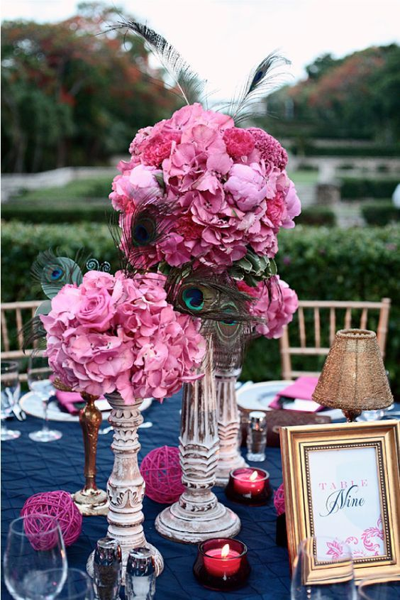 Ultra chic tall centerpieces with pops of fuchsia for a navy blue wedding reception. Photo: kristinviningphotoblog.