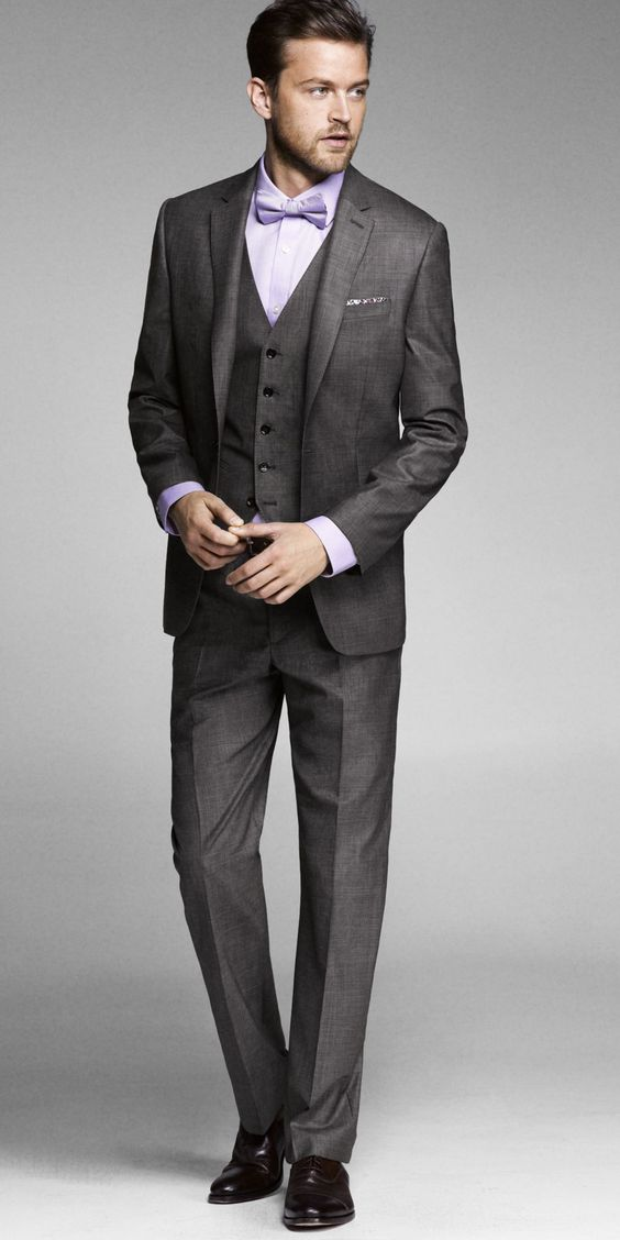 Three piece wedding suit in grey and lavender with bow tie and pocket square.