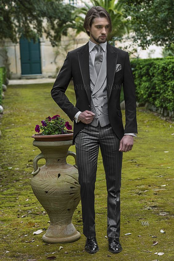 The tux is a classic amongst the different types of suits for grooms. Check out this Ottavio Nucci!