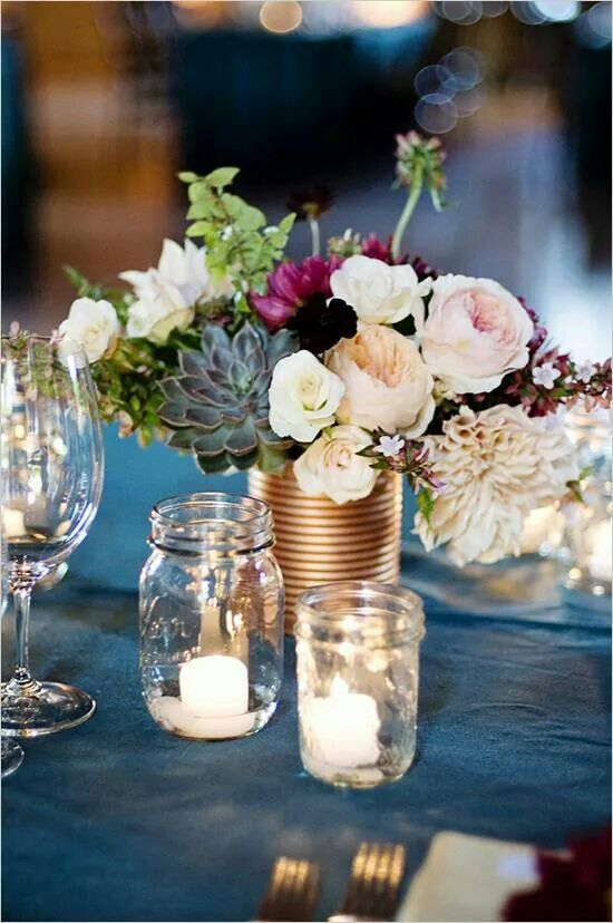Blue, blush and copper for a unique wedding centerpiece.