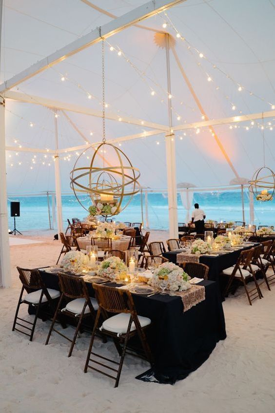 Making sure everything looks perfect for the big moment at this Bahamas reception. Stephen Karlisch- Karlisch Studio.