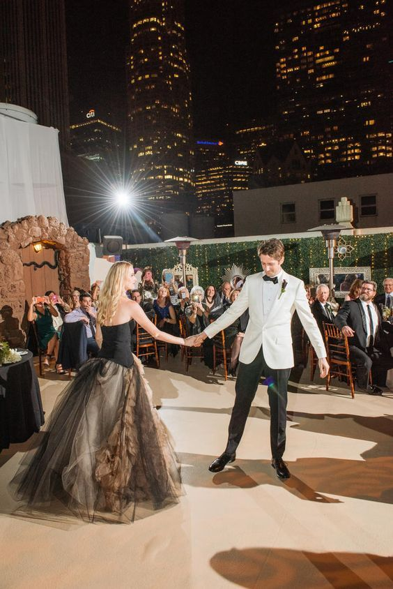 2018 wedding trends that steal our hearts. Ultra romantic Emperador color bridal gown at the modern Oviatt Penthouse rooftop in Los Angeles, California.