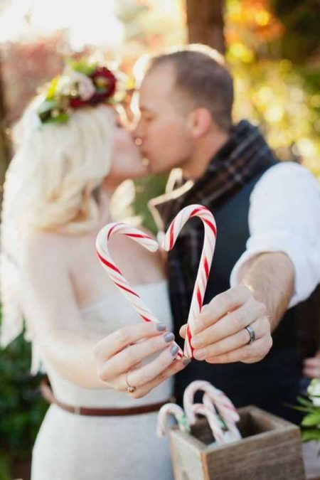 You know it's a Christmas wedding when there's candy canes on the wedding photos. Kim J. Martin Photography.